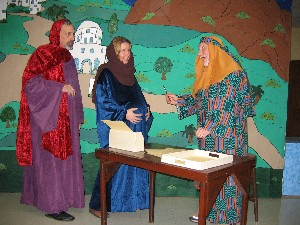Mary and Joseph with Census Counter